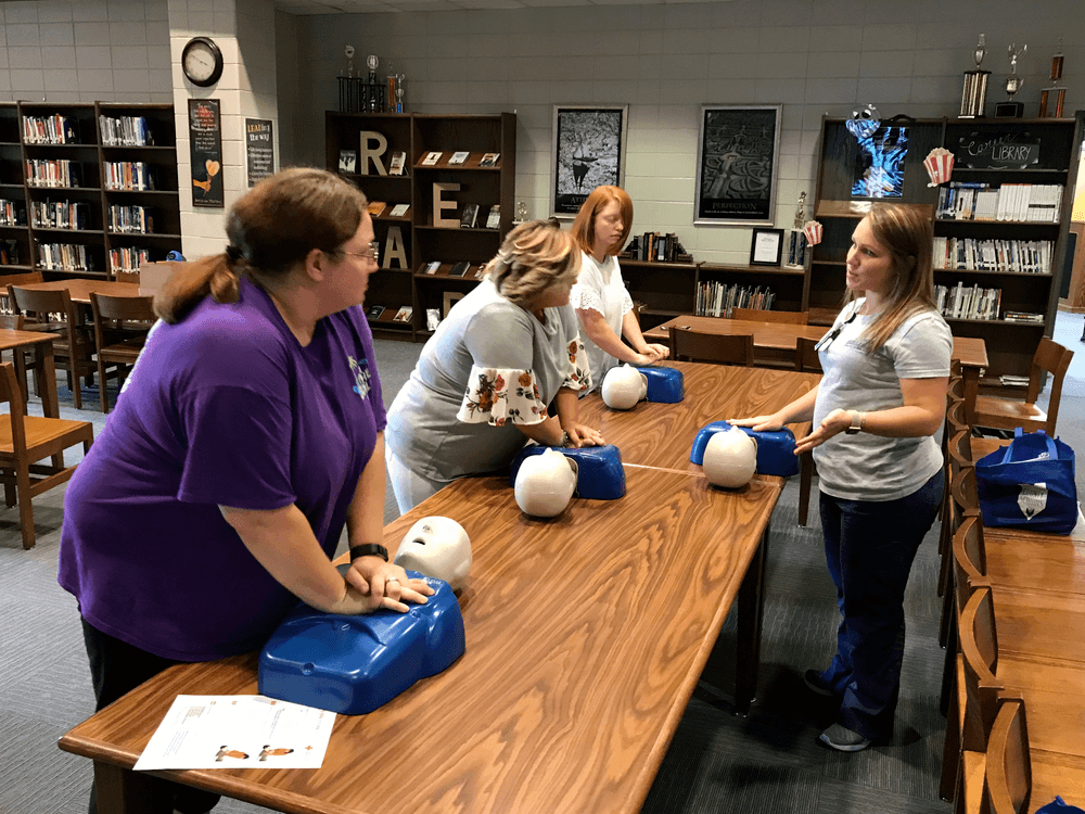 Employees participate in CPR training