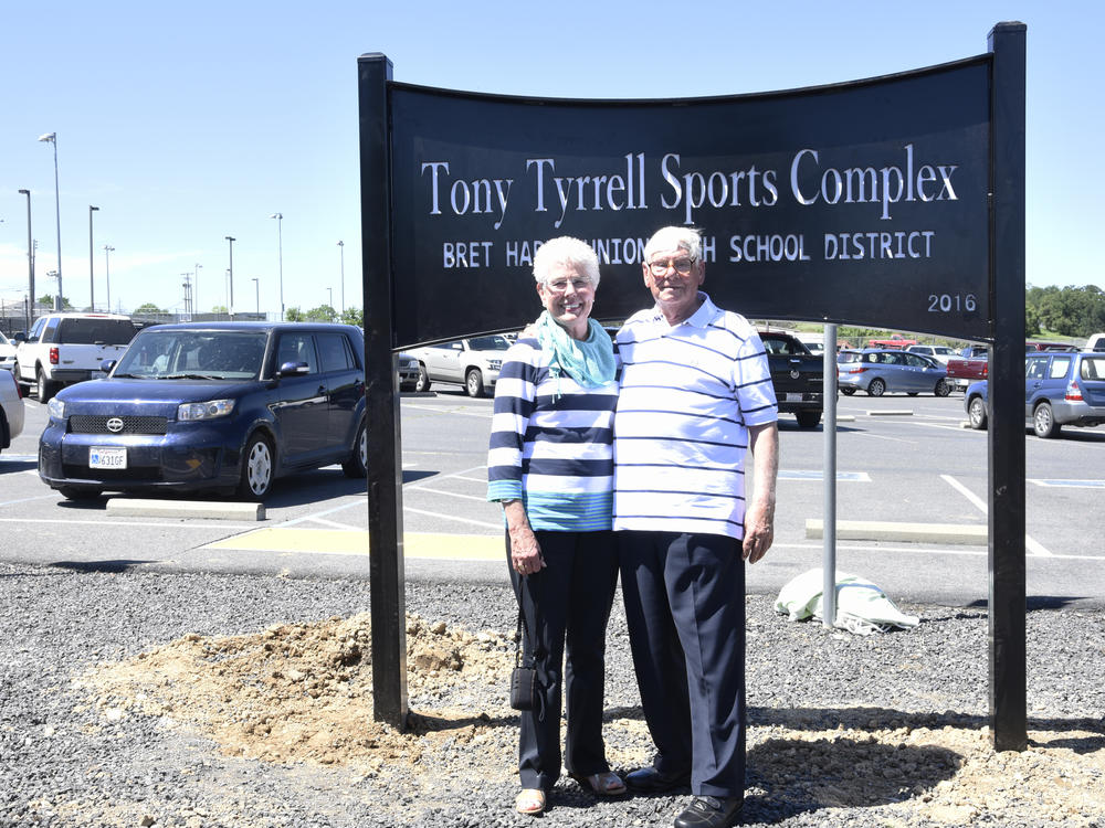 Tony and Carol in front of the Sports Complex sign