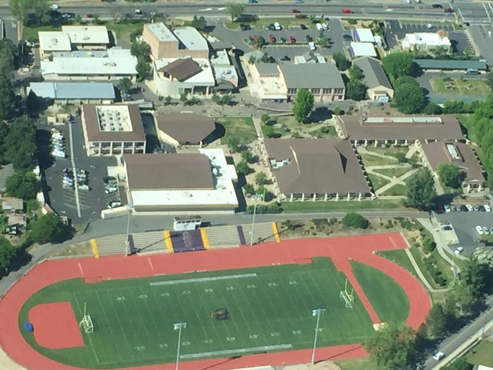 Aerial view of the student parking lot and the Aquatics Center