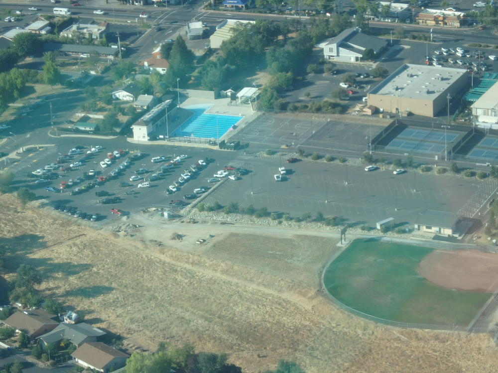 Aerial view of the football field and part of the school campus
