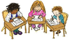 Children writing at their desks.