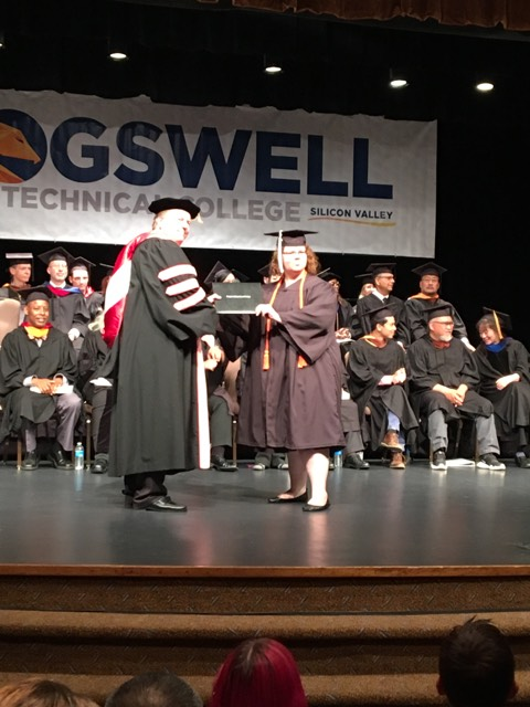 Sarah Wirkkala receiving her diploma.