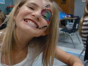 xochil got her face painted for day of the dead