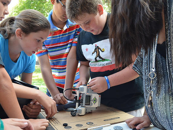 Students participating in robotics competition
