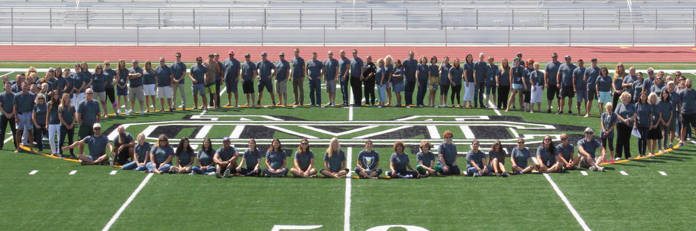 Staff on the new athletic field.