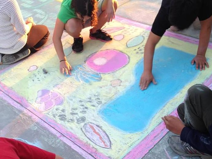 Chalk art being done by Delta students.