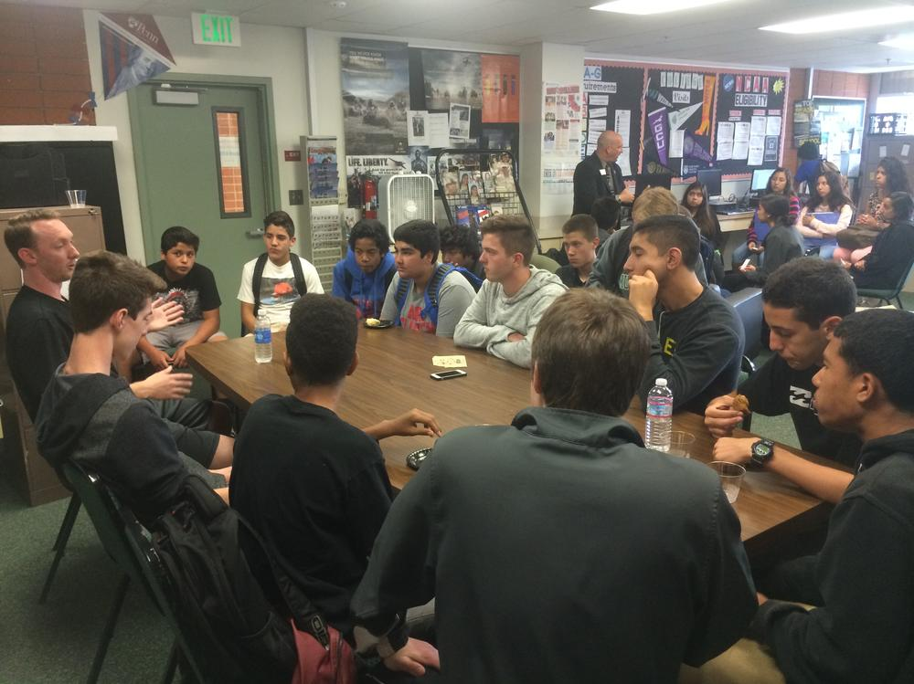 Students learning about a career as a college coach