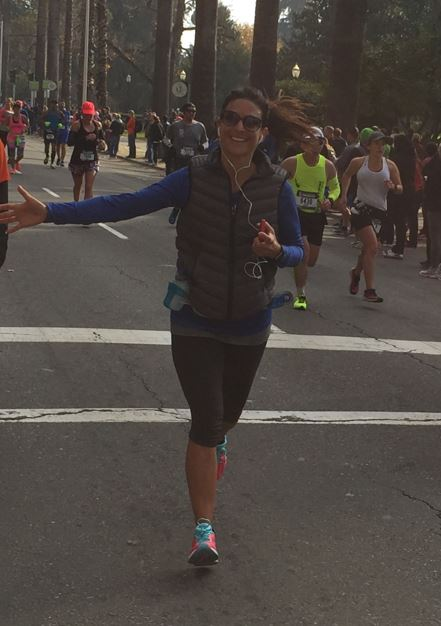 Ms. Gould running in a street event