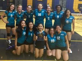 JV volleyball team poses with 1st place in division at JV Spikefest trophey