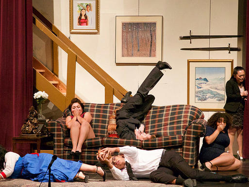 cast of Rumors performing final scene of first act