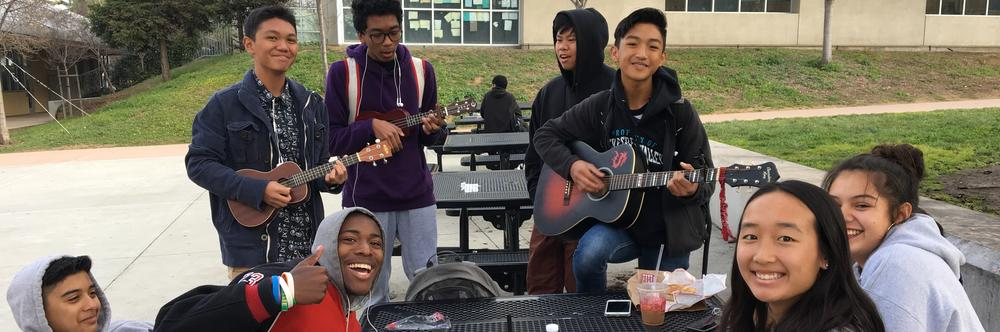 Students relaxing at break playing guitars