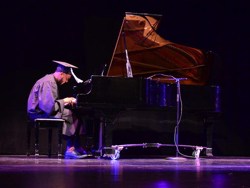 Ken Brooks Playing Piano at Commencement Ceremony