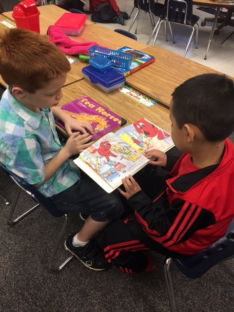 2 students read Clifford The Big Red Dog