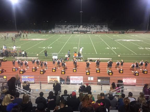 Photographs of the Estancia Cheerleading throughout the school year