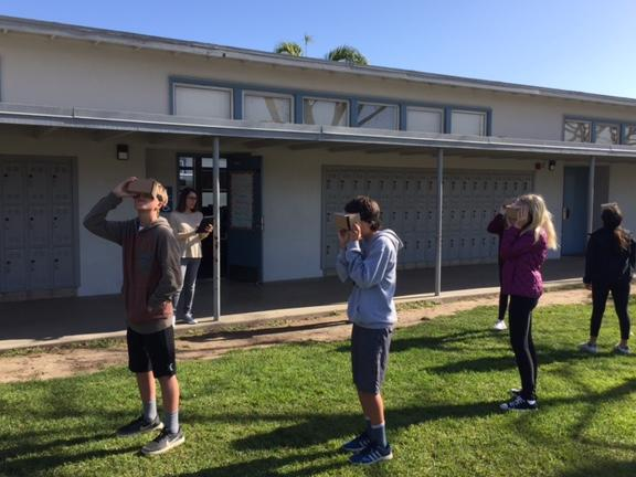 Ensign 7th grade history students using Virtual Reality goggles to explore  different European cathedral architecture