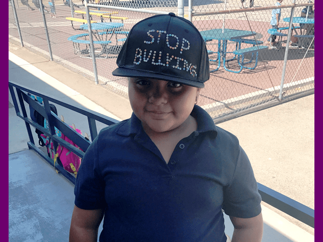 Put a cap on bullying, student wearing stop bullying cap
