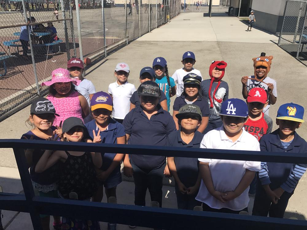 Room 25 students all wearing a cap for Put a cap on bullying day