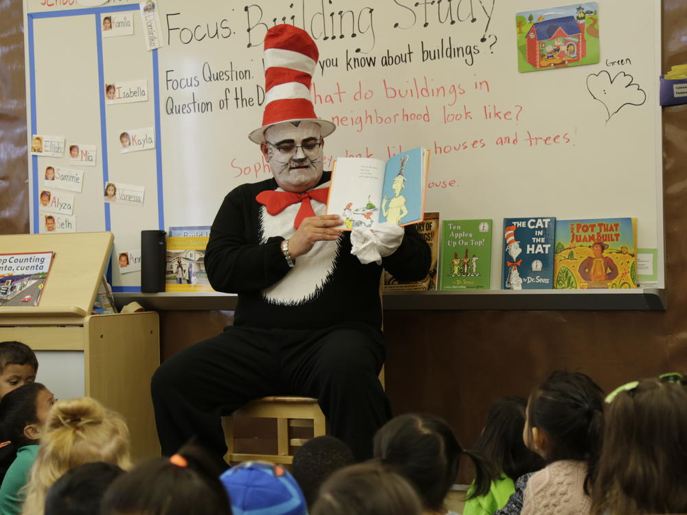 Cat In The Hat visited our school today, 3 6 19. The children enjoyed listening  to the story. Children also had a chance to eat some green eggs and ham!