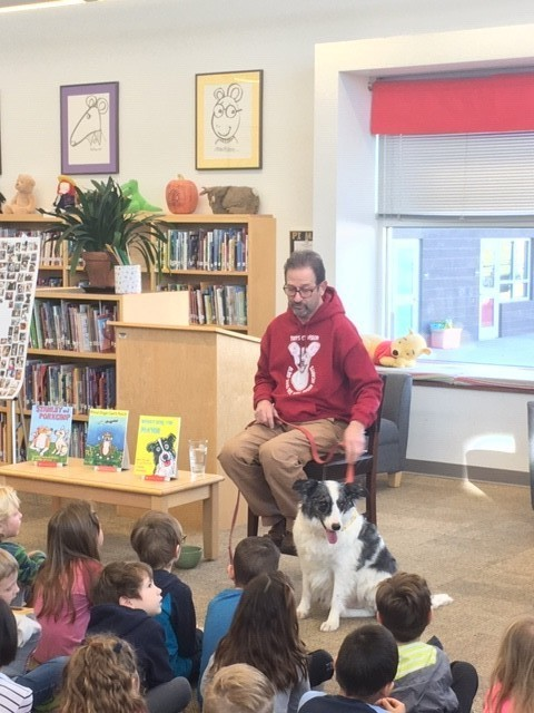 Author Edward Goodman and his dog at Georgia O Keeffe Elementary
