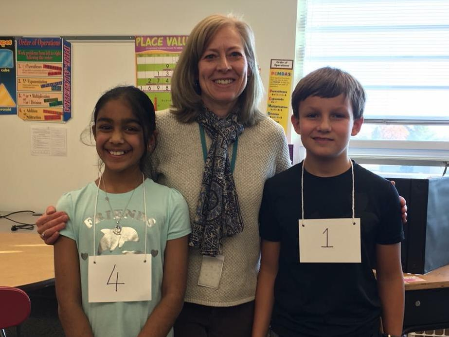 picture of geography bee winners with teacher