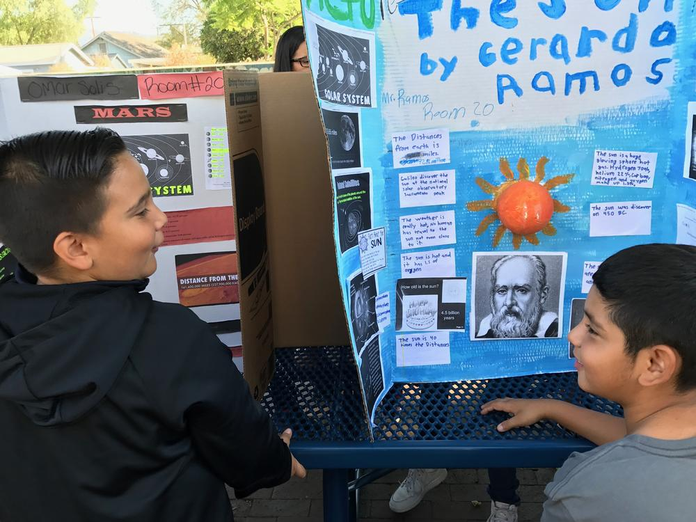 The fifth grade classes displayed their research on the solar system in the  courtyard. Students and faculty came to admire and support our students.