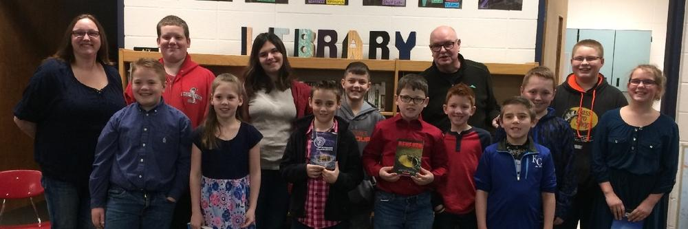 Elementary and Junior High students meet author, Roland Smith.