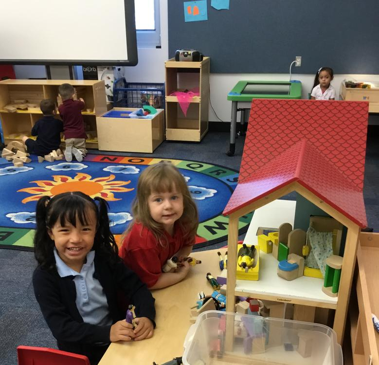 Students in front of doll house