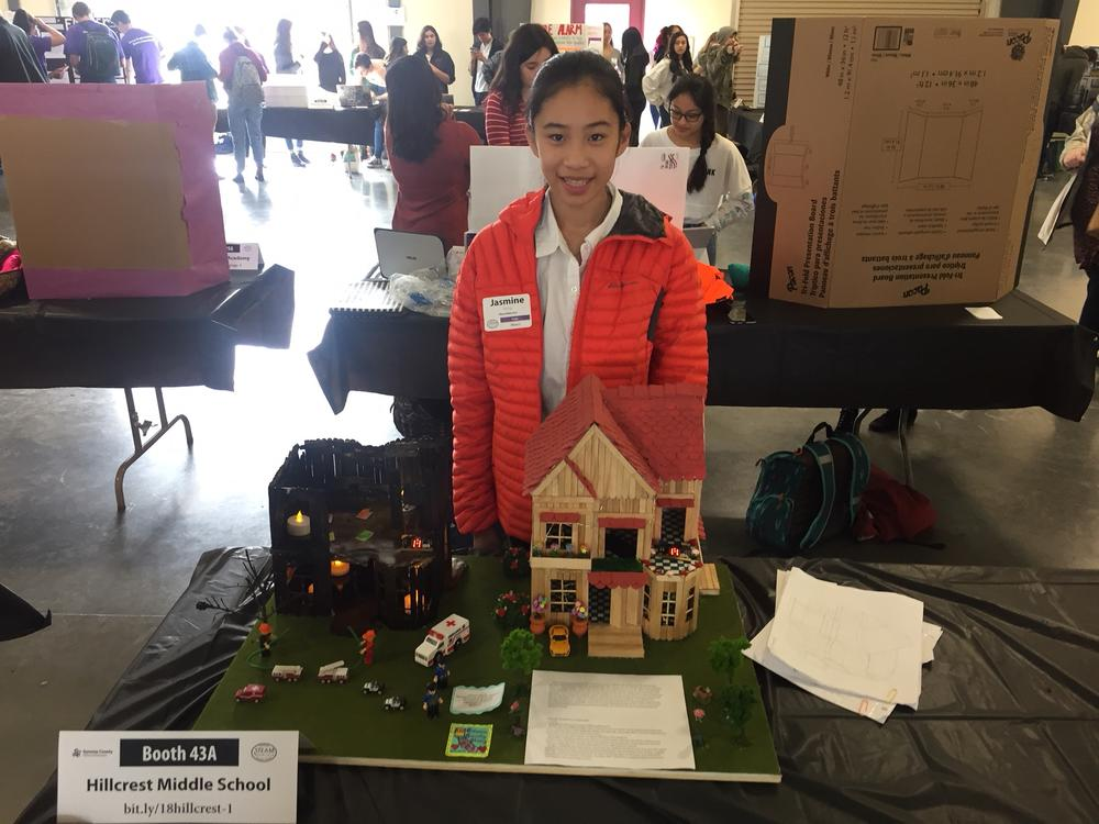 Student with STEAM project at showcase