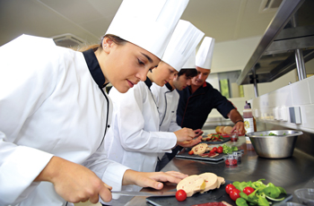 Culinary students prepping food in the kitchen