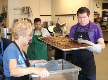 Adults with disabilities undertaking food service tasks