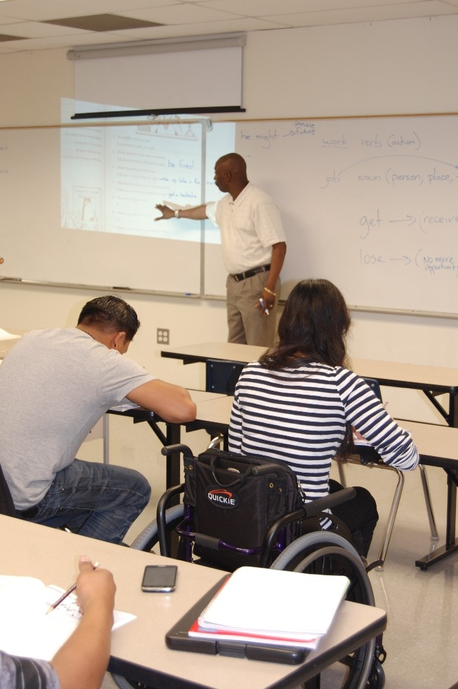 Teacher presenting to students in a classroom