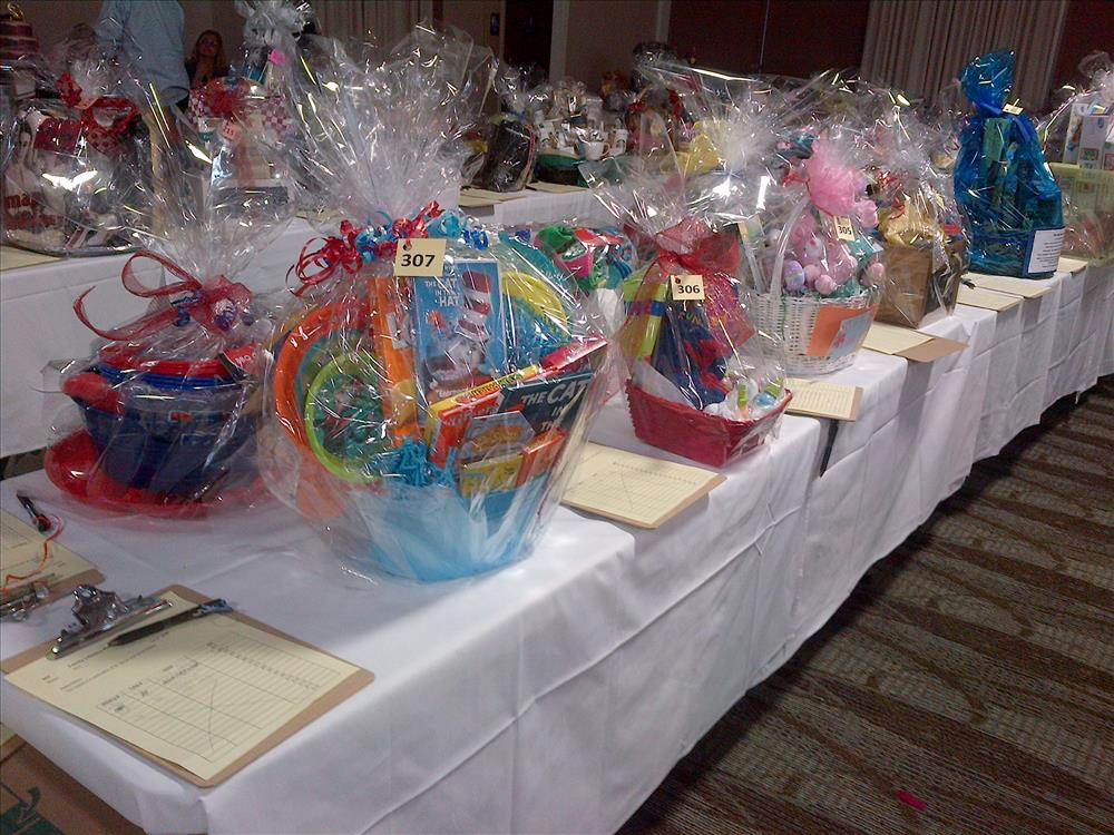 2014 scholarship dinner gift baskets on table