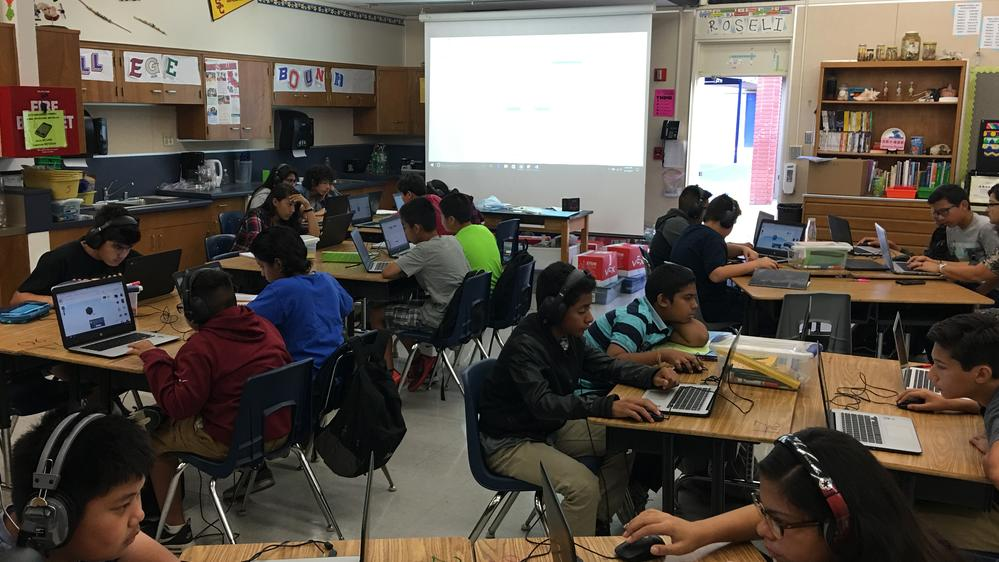 Students work together in a technology class.