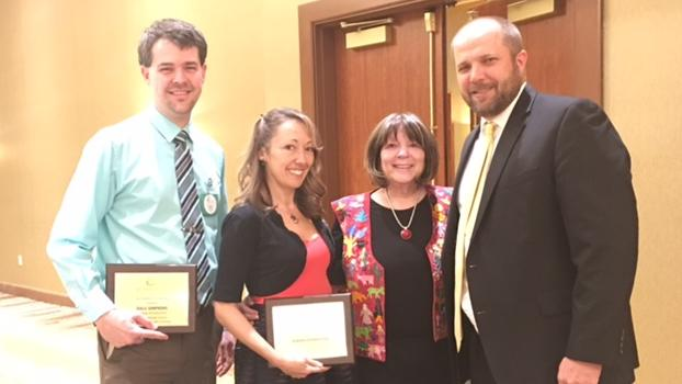 Hoover Teachers JoAnn Isonhood and Dale Simpkins pose with Superintendent  Raquel Reedy and Associate Superintendent Troy Hughes at the 2018 Golden Apple  Ceremony where they were recognized as Teachers of distinction.