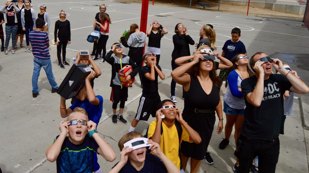 Students wearing safety glasses to look at the solar eclipse.