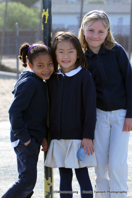 Three ISM students on the playground at recess