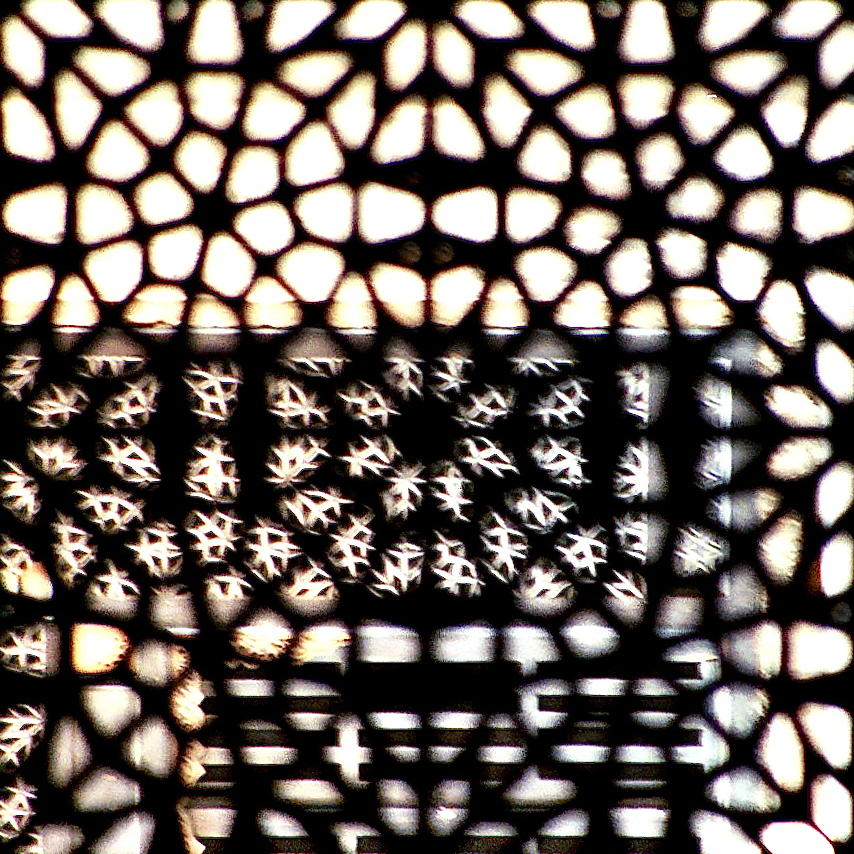 Looking through a pane at a mosque in Egypt.