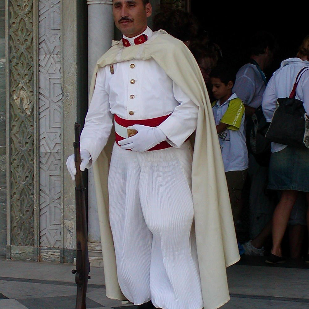 Guard outside the grave of an amir in Morocco.