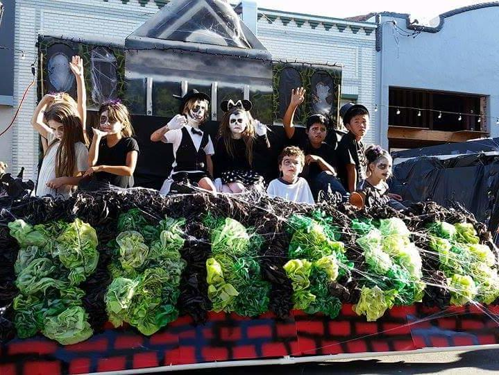 Student ghouls march in the 2015 Homecoming Parade ushering in the John Muir  Haunted Mansion.