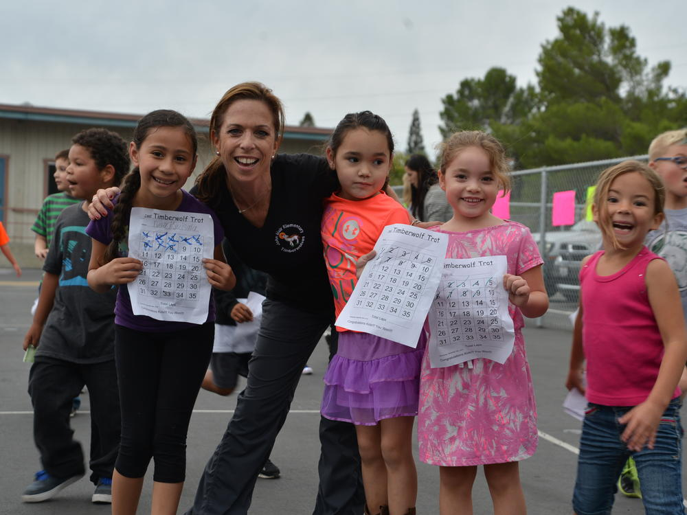 Principal Mrs. Thompson supports students during the annual Timberwolf Trot!