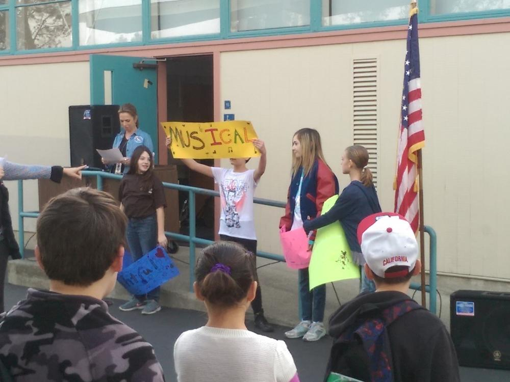 Students sing 'What I Am' at the JME Spring Walk & Talk.