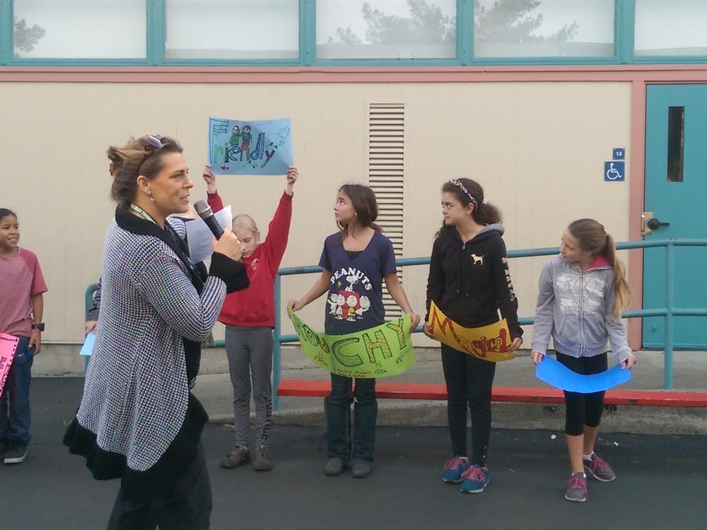 Music teacher, Ms. Morrow, leads students in a performance of the song 'What I  Am' at the John Muir Spring Walk & Talk event.