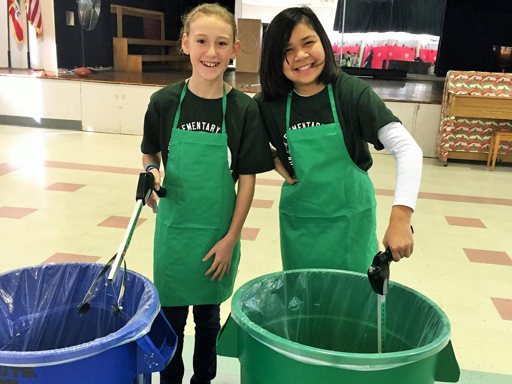 Students on the Green Team help collect recycling.