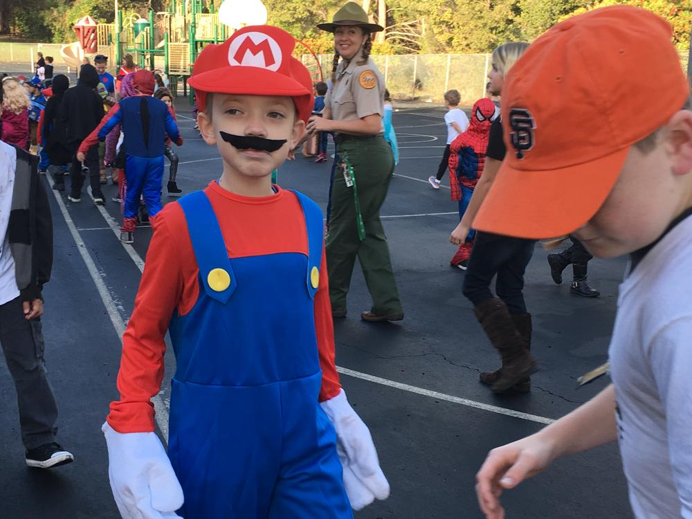 Halloween Parade 2016- Students walk the blacktop to display and share their  Halloween costumes