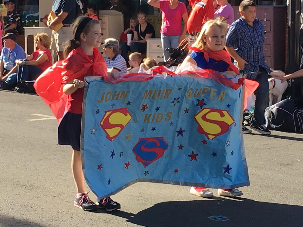 2016 Homecoming Parade - 3rd grade students lead the JME homecoming float,  Super Kids, down Main Street