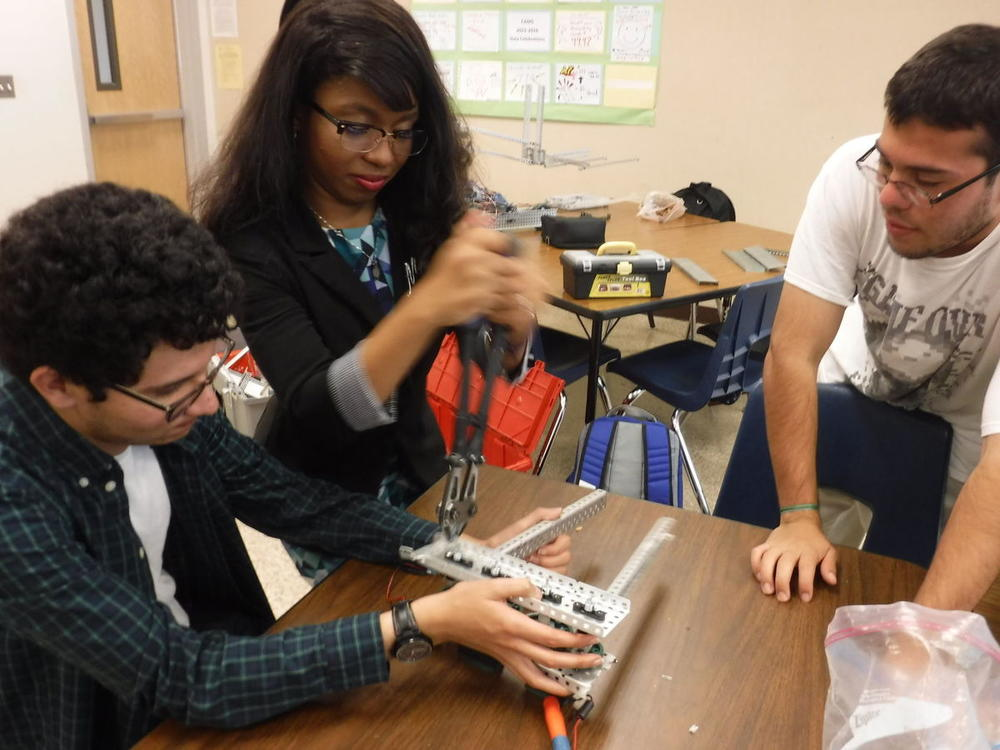 Students constructing robotics