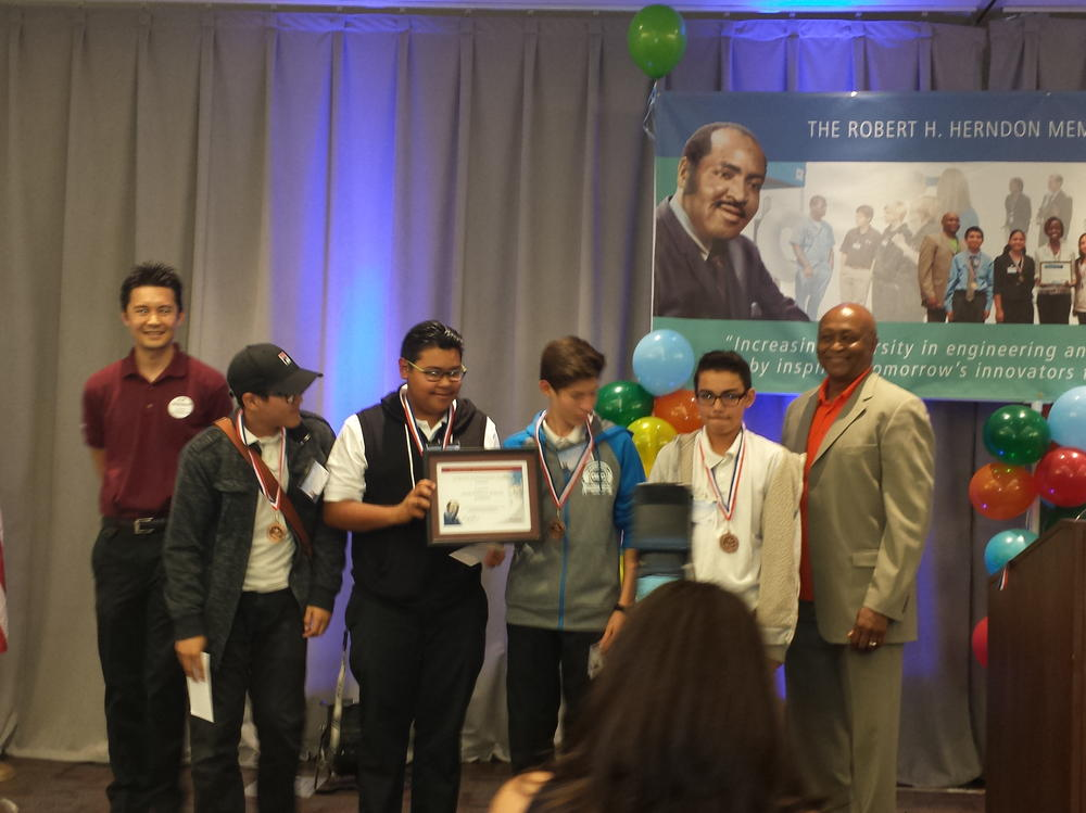 Jackie Robinson Academy accepting the 3rd place plaque for their participation  in the 38th Annual Robert Herndon Science Competition