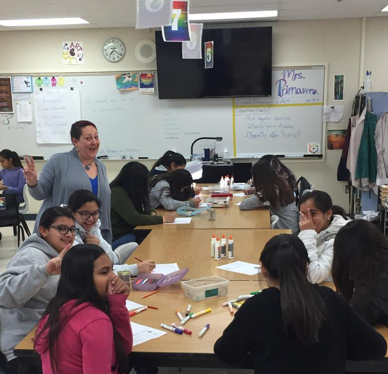 Ms. Primavera guiding students with an art lesson!