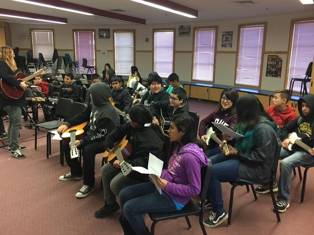 Learning guitar with Ms. Tolnai!