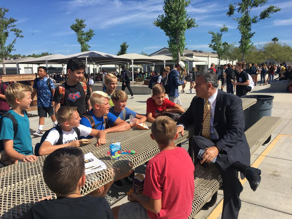 Principal chats with students